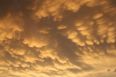 A beautiful midwest sunset with Mammatus clouds after a day filled with severe weather